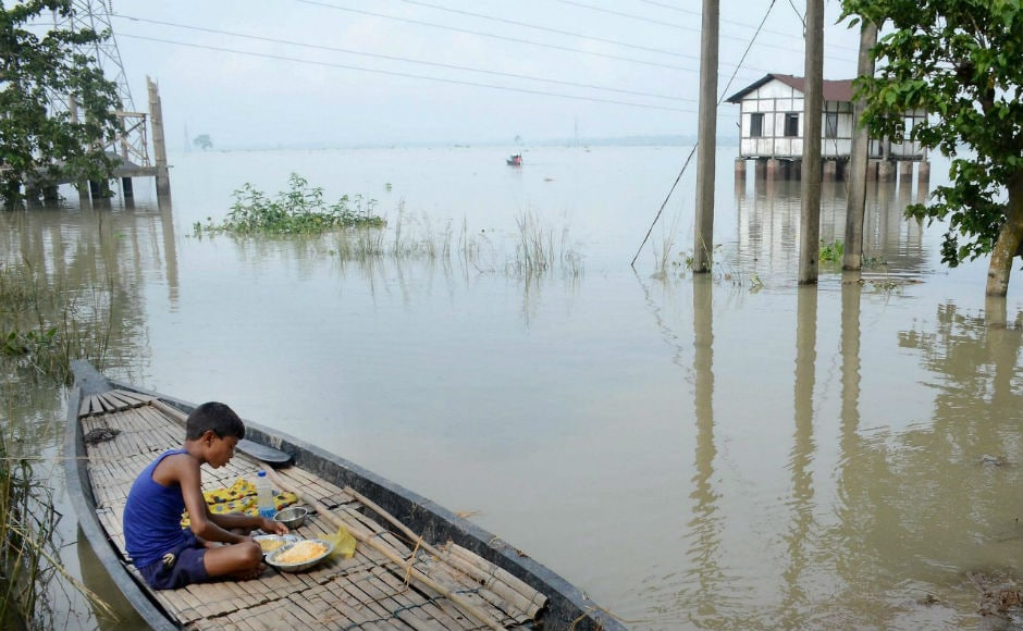 Hundreds of people were marooned in several inundated regions of Bihar and Assam even as heavy rains in other parts of the country flooded streets, choked traffic and hit normal life. PTI