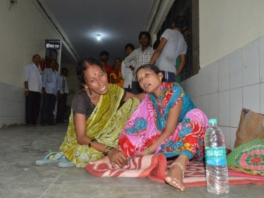 Family members and relatives mourn outside the BRD Hospital in Gorakhpur. PTI