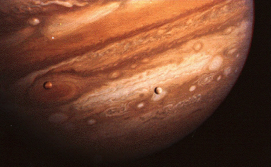 Jupiter with its moons in the foreground. Image: NASA.