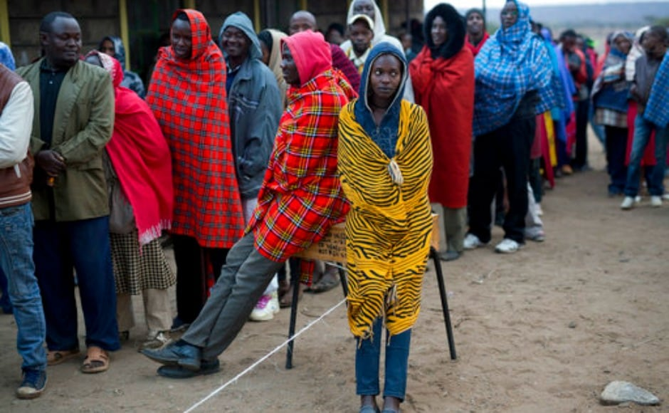 Kenyans line up to vote in Bissil , 120 km south of Nairobi, Kenya,Tuesday, Aug. 8, 2017. Kenyans are going to the polls to vote in a general election after a tightly-fought presidential race between incumbent President Uhuru Kenyatta and main opposition leader Raila Odinga. (AP Photo/Jerome Delay)