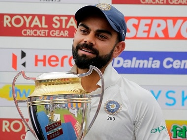 India's captain Virat Kohli holds the winners trophy after their Test series victory over Sri Lanka. AP
