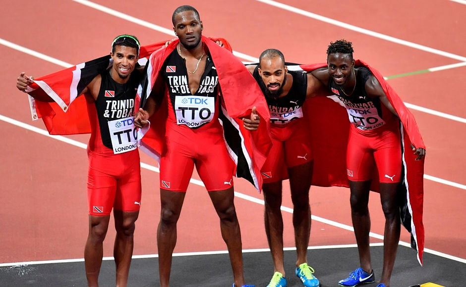 Trinidad and Tobago's gold medal winning team, from left, of Jarrin Solomon, Lalonde Gordon, Machel Cedenio and Jereem Richards celebrate after winning the gold in the men's 4x400m relay. This was the first-ever gold in the World Championships for the Caribbean nation. AP