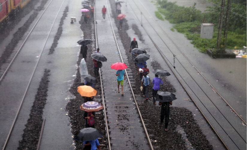 Having waited for hours on end with water showing no signs of receding, fidgety passengers were seen jumping off stationary trains and walking along the tracks to their destinations. Reuters