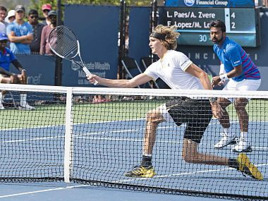 Alexander Zverev and Leander Paes in action in the opening round of the Cincinnati Masters. AFP