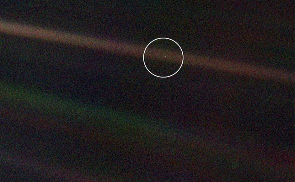 """The Pale Blue Dot, an image of the Earth taken from a distance of 6 billion kilometers. The image was captured on the request of astronomer Carl Sagan. While presenting the image, Sagan said, """"To my mind, there is perhaps no better demonstration of the folly of human conceits than this distant image of our tiny world. To me, it underscores our responsibility to deal more kindly and compassionately with one another and to preserve and cherish that pale blue dot, the only home we've ever known."""" Image: NASA."""