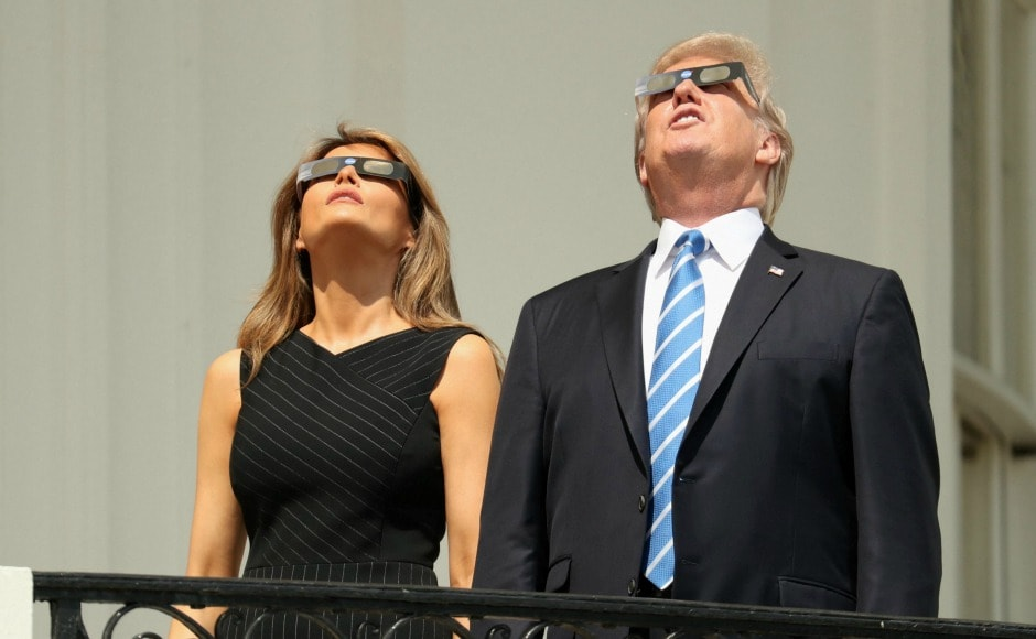 President Donald Trump and First Lady Melania Trump wore protective glasses to watch the eclipse from the White House. AP