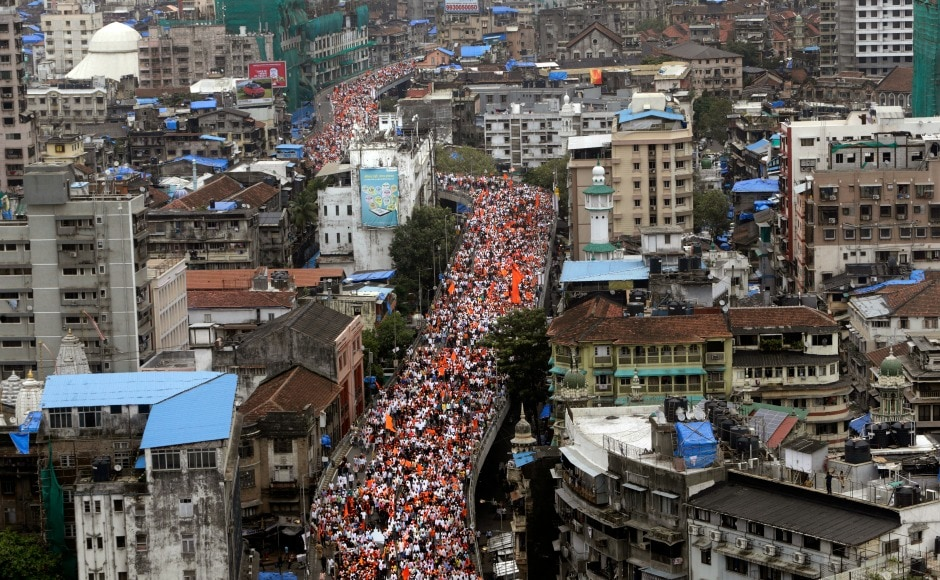 Wearing saffron caps and holding flags, the protesters marched towards the protest venue via JJ flyover in south Mumbai which had been closed for vehicular traffic. AP