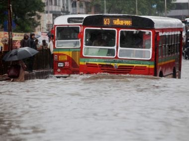 Buses ply waterlogged streets in Mumbai on Tuesday.PTI