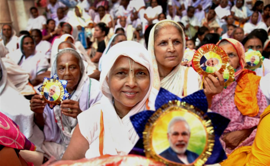 "Widows celebrate Raksha Bandhan and show their ""Modi Rakhi"" during a function organised by Sulabh International at Gopinath Temple in Vrindavan, Uttar Pradesh. PTI"
