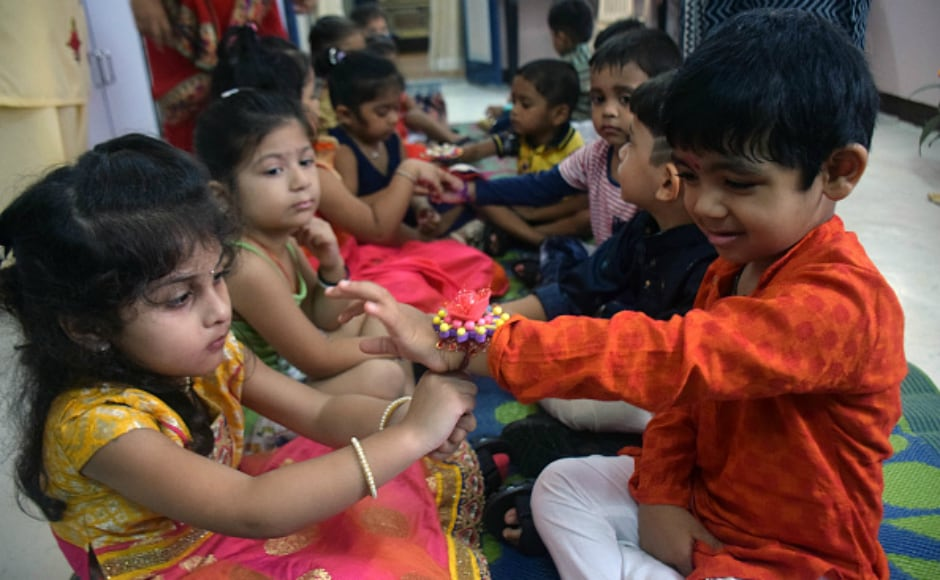 School students dress up in traditional attire to celebrate Raksha Bandhan festival in Thane, Maharashtra. Getty images