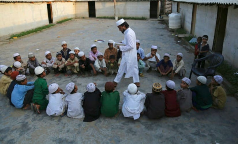 File image of Rohingya refugee children attending a Madrassa in a temporary shelter on the outskirts of Jammu. AP