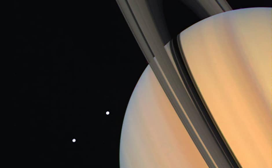 Saturn with Dione and Tethys. Image: NASA.