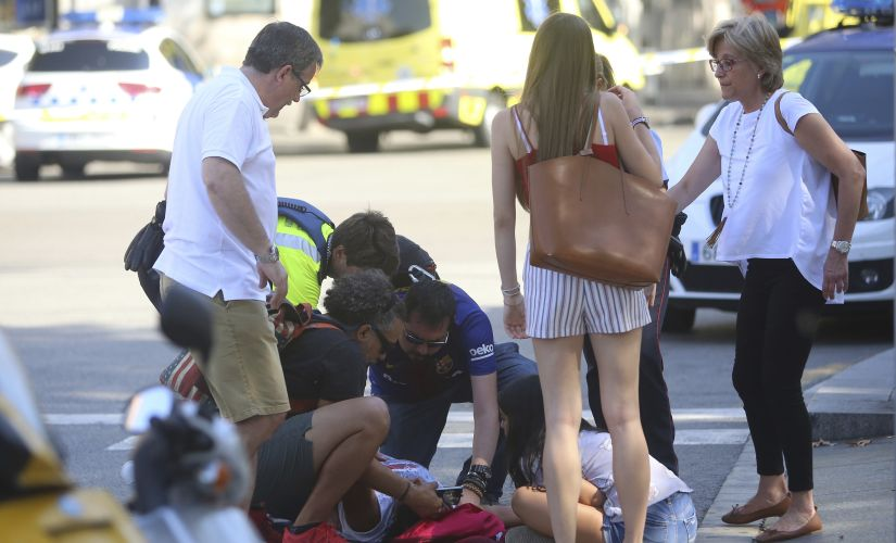 Paramedics treat an injured person after Thursday's terror attack in Barcelona. AP