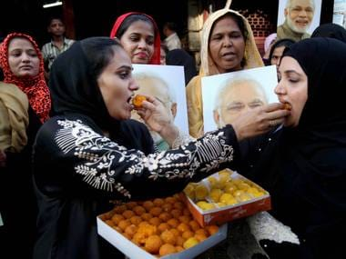Muslims women celebrate the Supreme Court's decision on Tuesday. PTI