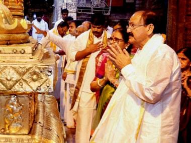 Tirupati: Vice President-elect M Venkaiah Naidu and his wife Usha offering prayers to the sacred 'Golden Altar' at the Lord Venkateswara temple, at Tirumala in Tirupati on Monday. PTI