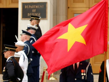 Vietnam flag flies. Reuters.
