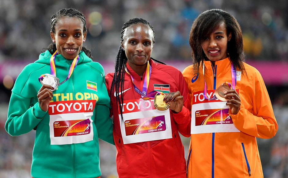 An astonishing last lap by Kenya's Hellen Onsando Obiri, centre, dashed Ethiopian Almaz Ayana's(L) dreams to win the 5000/10000m double. This was Obiri's first major title. Ayana won the silver while Netherlands' Sifan Hassan(R) claimed the bronze. AP