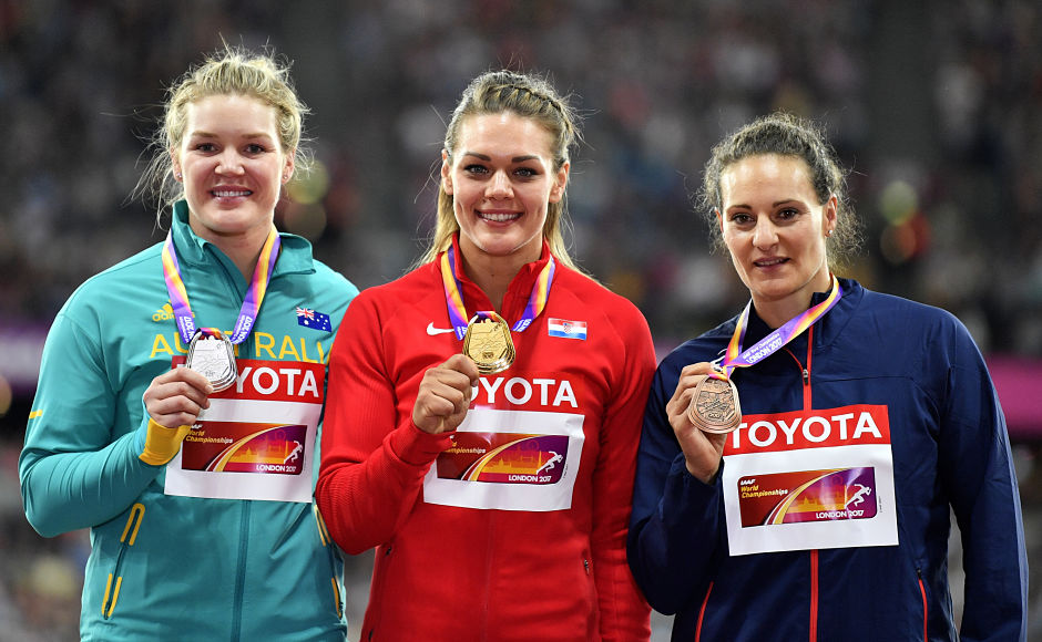 Double Olympic champion Croatia's Sandra Perkovic, centre, won her second world title in the discus throw event. Perkovic was the only athlete to have thrown over 70 metres at this year's Championships final. Australia's Dani Stevens(L) won the silver while France's Melina Robert-Michon(R) grabbed the bronze. AP