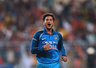 India's Kuldeep Yadav celebrates after completing his hat-trick against Australia. AFP