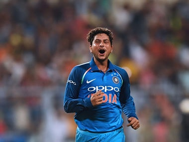 India's Kuldeep Yadav celebrates after completing his hat-trick after taking the wicket of Australia's Pat Cummins during the second one day international(ODI) match of the ongoing India-Australia cricket series at the Eden Gardens Cricket Stadium in Kolkata on September 21, 2017. / AFP PHOTO / Dibyangshu SARKAR / ----IMAGE RESTRICTED TO EDITORIAL USE - STRICTLY NO COMMERCIAL USE----- / GETTYOUT