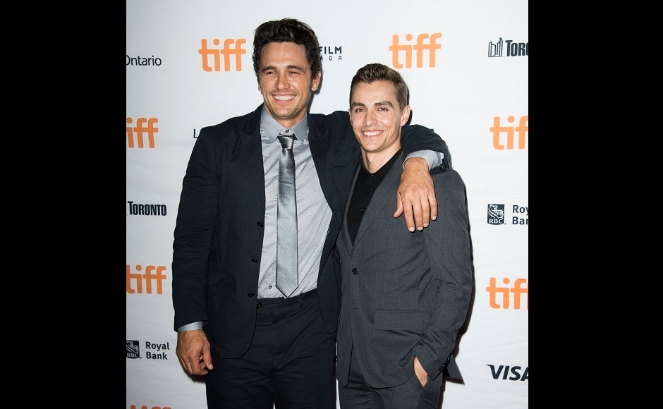 James Franco, left, and Dave Franco attend a premiere for The Disaster Artist on day five of the TIFF at the Ryerson Theatre on Monday, 11 September, 2017. Photo by AP