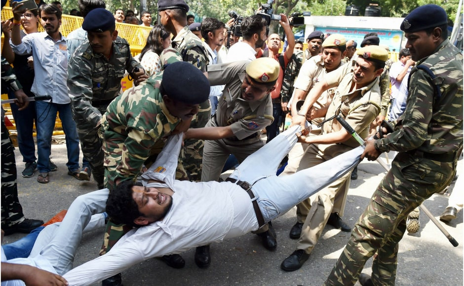 Delhi Police detained several students who tried to jump the barricades put up at Shastri Bhawan . PTI