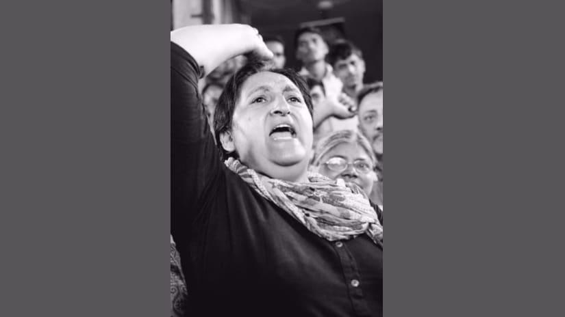 Nisha Sidhu of National Federation of Indian Women raising slogans in support of the Karwan e Mohabbat at Bardod, few kilometers ahead of Behror, Alwar, Rajasthan