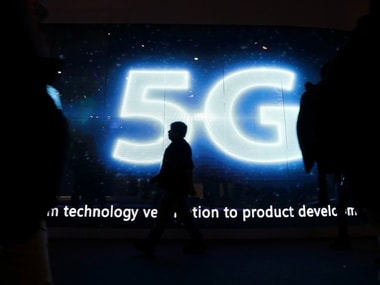 A visitor walks past a 5G sign during Mobile World Congress. Reuters