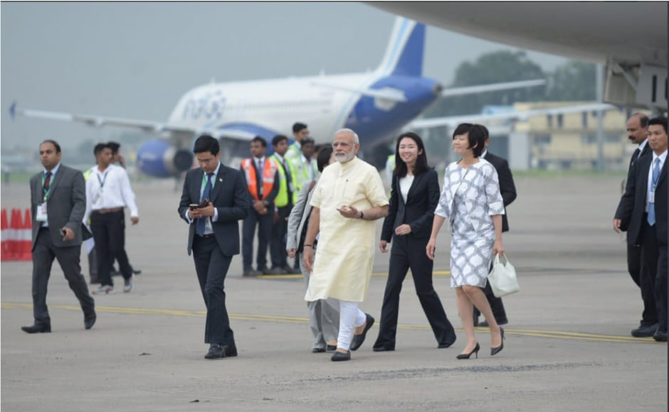 Shinzo Abe receives warm welcome at Ahmedabad airport Narendra Modi extends bear hug