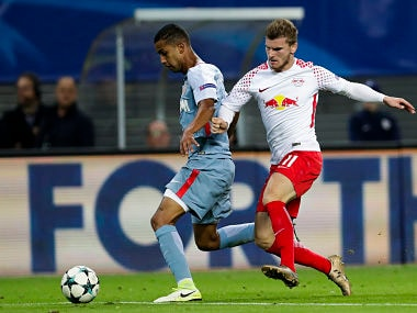 Monaco's Jorge, left, and Leipzig's Timo Werner, right, challenge for the ball during the Champions League match between RB Leipzig and AS Monaco FC. AP
