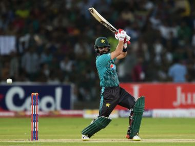 Pakistani batsman Ahmed Shehzad plays a shot during the third T20I match against the World XI. AFP