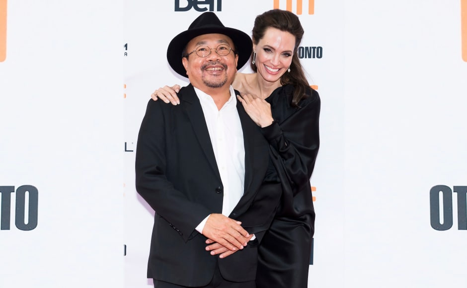 The event took place at the Princess of Wales Theatre on 11 September. Here Jolie is seen posing with Rithy Panh. Image from AP.