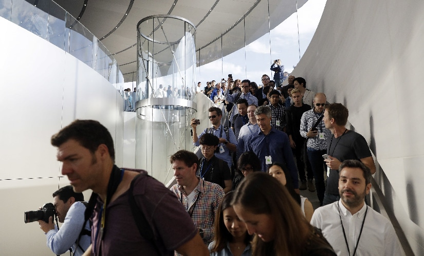 People arrive for a new product announcement at the Steve Jobs Theater. Image: AP Photo.