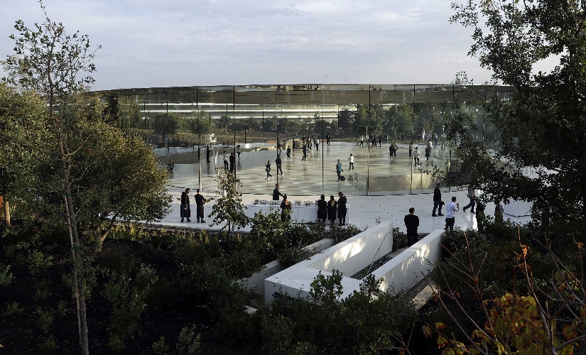 People arrive for a new product announcement at the Steve Jobs Theater on the new Apple campus. Image: AP Photo