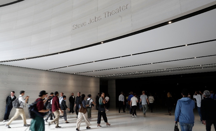 People enter the Steve Jobs Theater before the start of the event. Image: Reuters