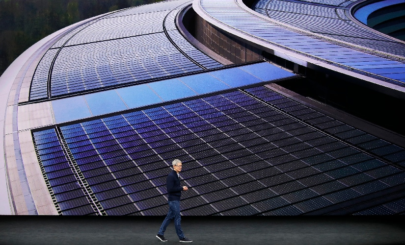 Cook showed pictures of the finished Apple spaceship campus detailing the focus on renewable energy. Image: Reuters