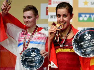 Viktor Axelsen and Carolina Marin won the Japan Open Superseries title in men's and women's singles respectively. AFP