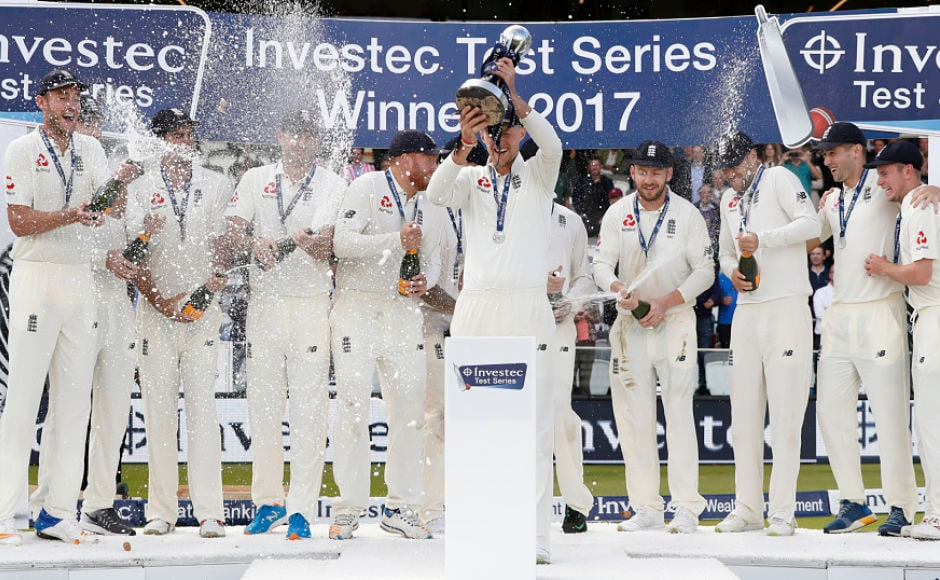 England captain Joe Root lifted The Wisden trophy after England turned things around in the 3rd Test to clinch the series 2-1 overcoming West Indies' total in the 2nd innings with 9 wickets in hand on Day 3 as teammates pop champagne in celebrations. AP