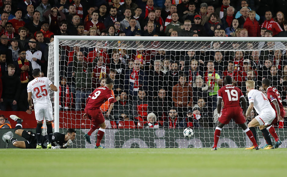Roberto Firmino scored for Liverpool but also missed a penalty against Sevilla as the Merseysiders took a 2-1 lead at halftime. AP