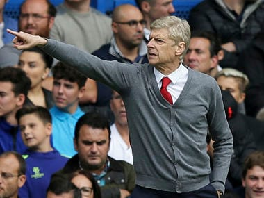 Arsenal manager Arsene Wenger gives directions to his players during the Premier League soccer match against Chelsea at Stamford Bridge. AP