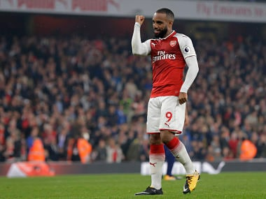 Arsenal's Alexandre Lacazette celebrates after scoring his sides second goal from the penalty sport during their English Premier League soccer match between Arsenal and West Bromwich Albion at the Emirates stadium in London Monday, Sept. 25, 2017. (AP Photo/Alastair Grant)