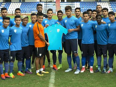 Senior India team captain Sunil Chettri along with U 17 India players pose with the new kit. Image courtesy: Twitter @IndianFootball