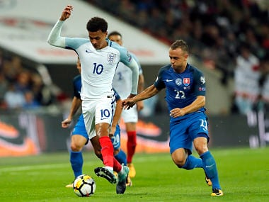 England's Dele Alli, left, and Slovakia's Stanislav Lobotka, right, challenge for the ball during match between England and Slovakia. AP
