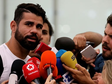 Diego Costa speaks to media upon arriving at Adolfo Suarez Madrid Barajas airport in Madrid, Spain. Reuters