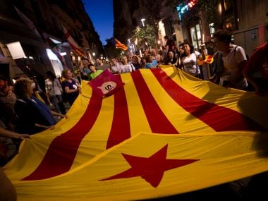 "File image of people carrying ""esteladas"" or independence flag in Barcelona. AP"