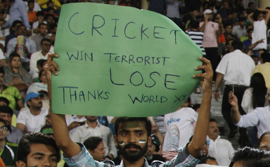 A fan at the Gaddafi Stadium holds a placard during the third T20I between Pakistan and World XI. AP