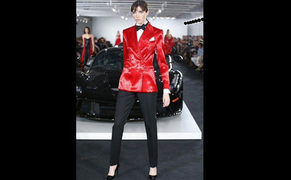 Another model poses in a red bespoke suit, at Ralph Lauren's fashion show. Image from AP.