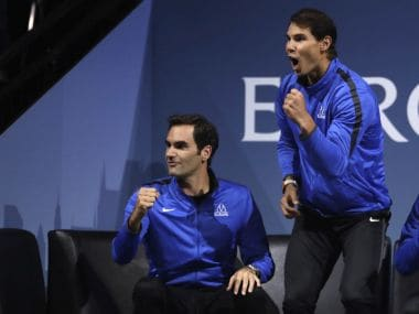 Europe's Roger Federer, left, and Rafael Nadal, right, watch the Laver Cup tennis match between Europe's Dominic Thiem and World's John Isner in Prague, Czech Republic, Friday, Sept. 22, 2017. The competition pits a team of the best six European players against the top six from the rest of the world. It is named after Australian tennis legend Rod Laver. (AP Photo/Petr David Josek)