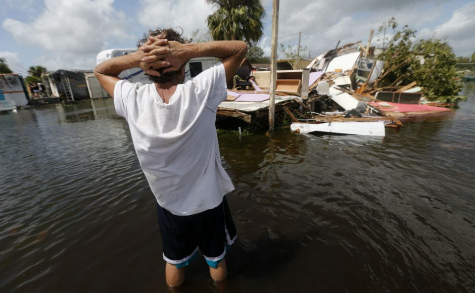 Federal officials in the state estimated that a quarter of the homes were destroyed, and hardly any escaped damage. Roofs seemed peeled off by can-openers and power poles were nowhere to be seen. AP