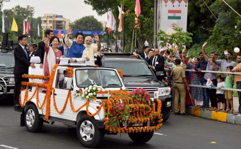 Hundreds of people lined the route as Abe and Modi were driven in a white open jeep decorated with garlands. PTI